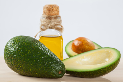 Fresh avocado and a bottle of oil